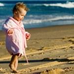 Baby walking on the beach — Stock Photo