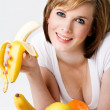 Young beautiful female eating a bananna - Stock Photo
