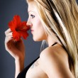 Profile of young female with flower — Stock Photo