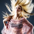Beautiful blond female with flying hair — Stock Photo