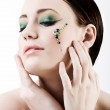 Young woman with green makeup — Stock Photo
