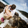 Passionate young couple getting married on the beach - 