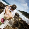 Passionate young couple getting married on the beach - Stock fotografie