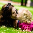 Mother and daughter kissing — Stok fotoğraf