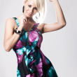 Young blonde woman in colorful dress — Stock Photo #4728848