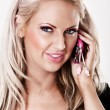 Blonde woman with pink makeup talking on phone — Stock Photo