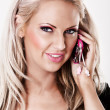 blonde woman with pink makeup talking on phone — Stock Photo #4728892