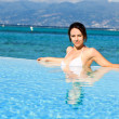 Young woman in white bikini resting on holidays - Stockfoto