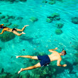 Stock Photo: Young couple snorkeling in cletropical water