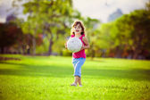 Young girl in the park holding white ball — Stock Photo
