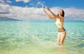 Young woman having fun splashing water — Stock Photo