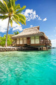 Over water bungalow with steps into lagoon — Stock Photo