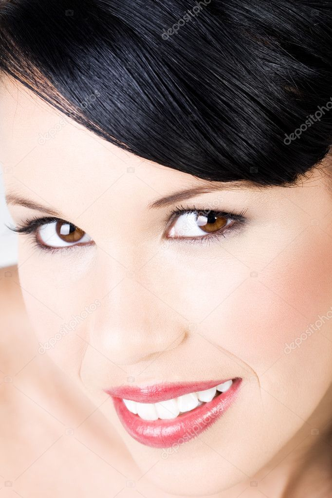 Young beautiful female wearing makeup with gentle smile  Stock Photo #4728546