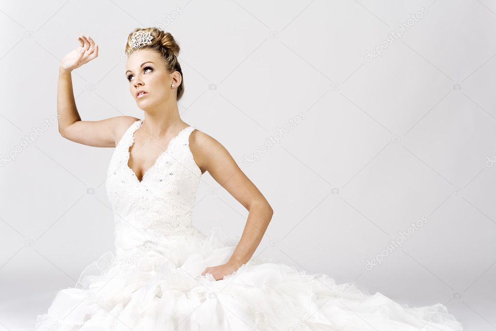 Hi-fashion bride sitting and thinking on the floor  Stock Photo #4728568
