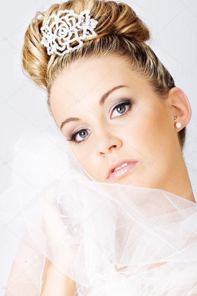 Young beautiful bride holding a veil  Stockfoto #4728570