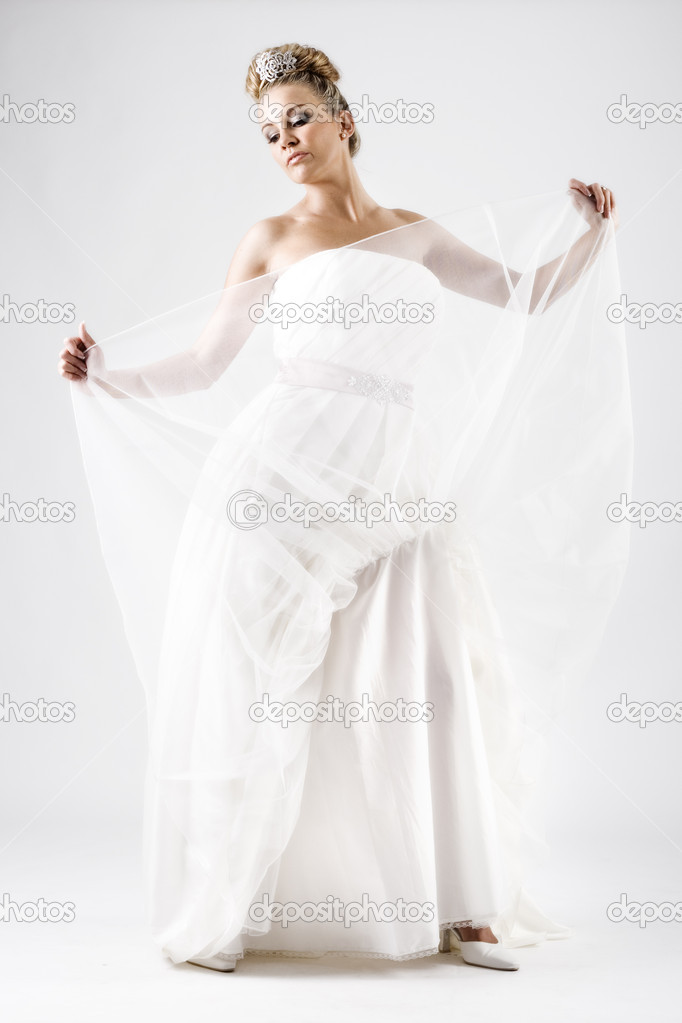Young sensual bride playing with a wedding dress — Stock Photo #4728571