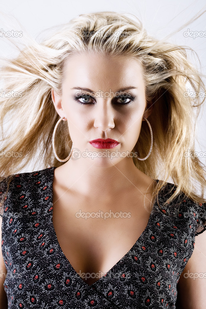 Gorgeous young seductive blond female with flying hair  Stock Photo #4728573