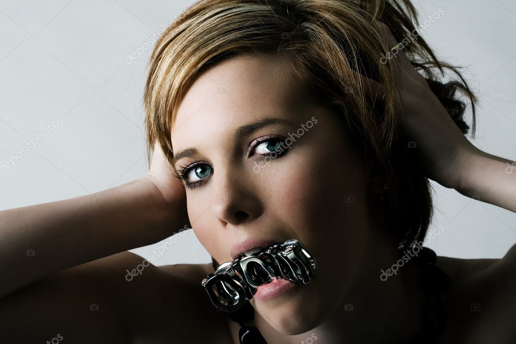 Portrait of a young female biting on jewelery — Stock Photo #4728587