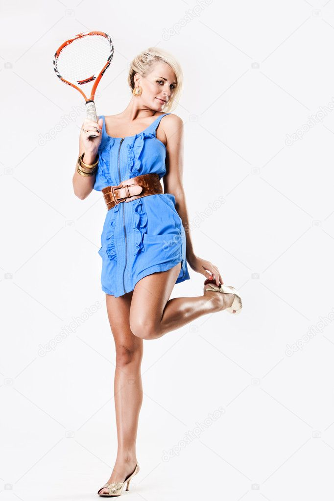 Young tennis fashion model in blue dress and heels — Stock Photo #4728846