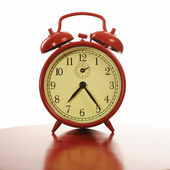 Traditional red alarm clock — Stock Photo