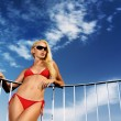 Young woman in a red bikini — Stock Photo