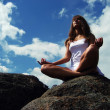 Royalty-Free Stock Photo: Girl meditating on a mountaintop