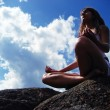 Stock Photo: Girl meditating on a mountaintop