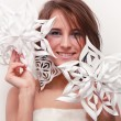 Portrait of young girl with makeup and cut snowflakes — Stockfoto