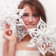 Portrait of young girl with makeup and cut snowflakes — Stock Photo