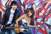 Young couple play on guitars — Stock Photo
