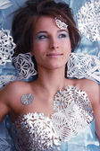 Portrait of young girl with cut snowflakes — Stock Photo