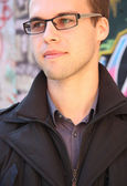 Portret of young man in glasses — Stock Photo