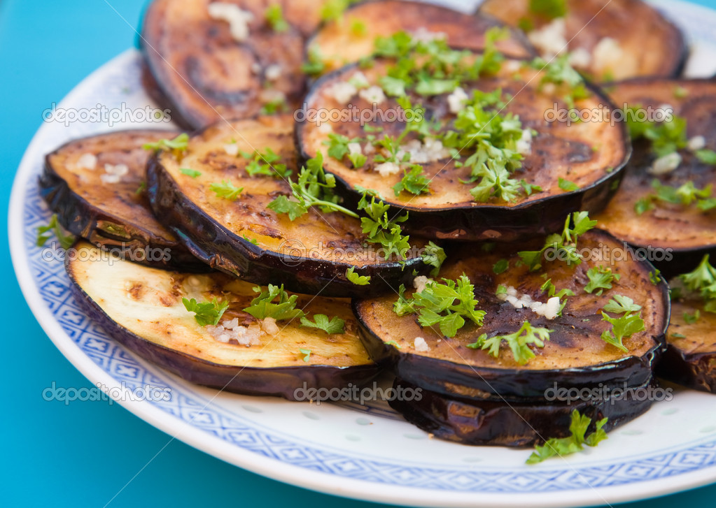 Fried aubergines (eggplant) with freshly grated garlick and parsley  Stock Photo #4432676