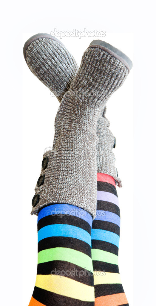 Stripy legs - female legs in brightly colored stockings and knit-top boots; isolated on white — Stock Photo #4463858
