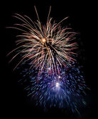 Few fireworks blasts on black sky - long exposure; — Stock Photo