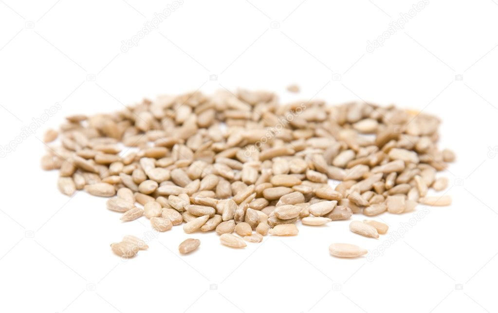 Handful of sunflower seeds isolated on white — Stock Photo #4513304