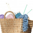Overflowing knitter's basket, isolated on white - Stock Photo