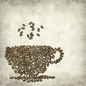 Textured old paper background with cup made of coffee beans — Stock Photo