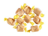 Fudge sweeties in transparent wrappers — Stock Photo