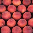 Royalty-Free Stock Photo: Red ripe peaches for sale at a marketplace;