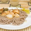 Fried scallops on stir-fried buckwheat noodles — Stock Photo