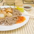 Royalty-Free Stock Photo: Fried scallops on stir-fried buckwheat noodles