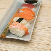 Sushi on grey ceramic plate, soy sause — Stock Photo
