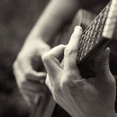 Playing acoustic guitar, barre chord — Stock Photo