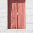 Pink door in white brick wall, high above the ground — Stock Photo #4933691