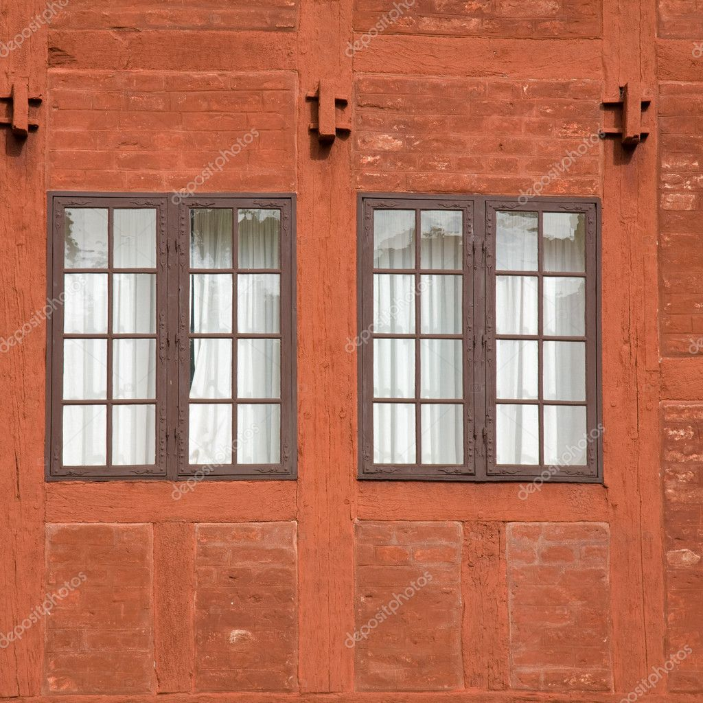 Two old multipanel windows in a terracotta colored brick and wood wall, house, building, old-fashioned, architectural, detail, two, curtained — Stock Photo #4950138