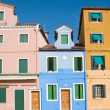 Burano island in lagoon of Venice; famous brightly-colored houses; — Stock Photo #5033295
