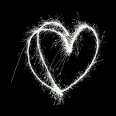 Symbolic heart shape drawn in the air with a sparkler trail — Stock Photo