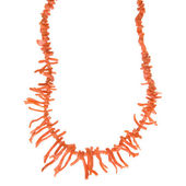 Simple necklace of red-orange coral branches isolated on white background — Stock Photo