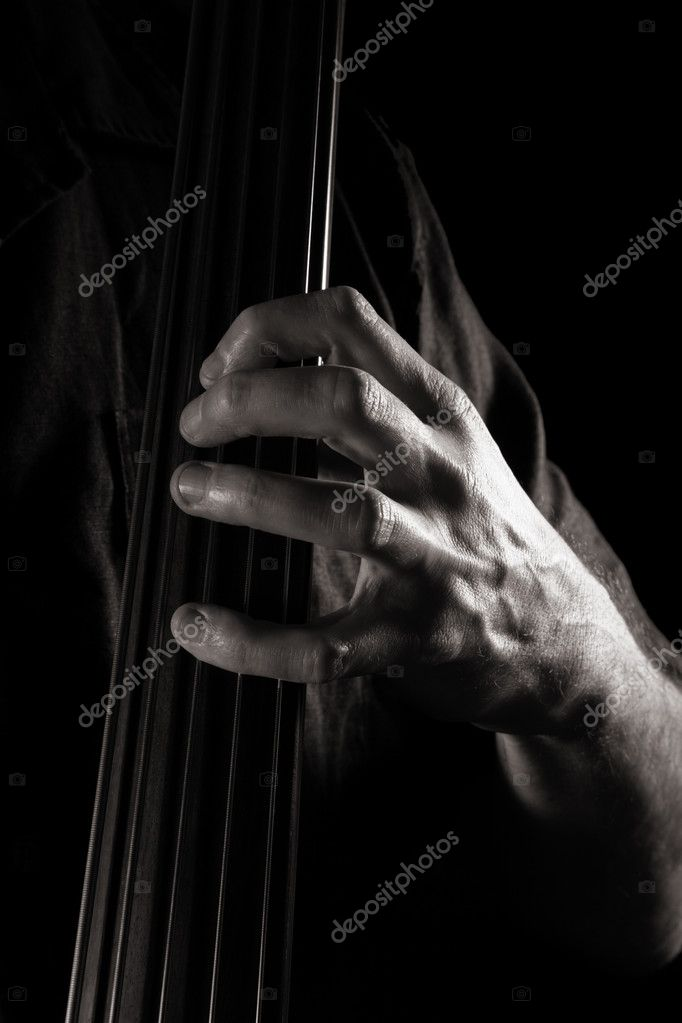 Male hand on the fingerboard of electric double bass; toned monochrome image;  — Stock Photo #5205519